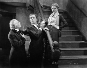Emile Chautard, Earle Fox, and Nancy Nash in a scene from UPSTREAM, 1927.